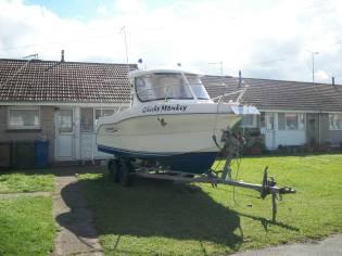Quicksilver 580 fishing boat